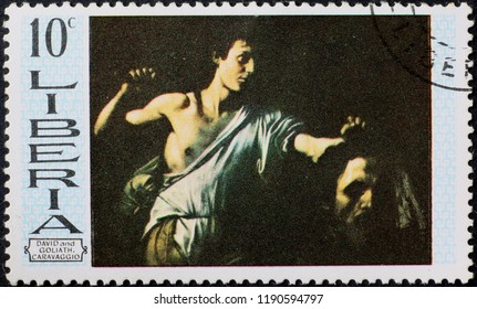 Milan, Italy – July 28, 2018: David and Goliath by Caravaggio on postage stamp