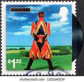Milan, Italy – July 28, 2018: Cover of Earthling by David Bowie on postage stamp