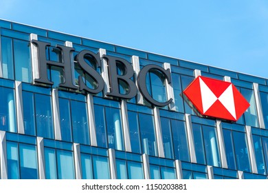 Milan, Italy - July 29, 2018: HSBC sign outside a glass skyscraper. British-based multinational banking and financial services company headquartered in London, it is the world's fourth largest bank