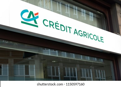 "Milan, Italy - July 29, 2018: Crédit Agricole bank branch, sometimes called ""la banque verte"", a French network of cooperative and mutual banks"