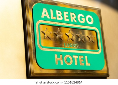 Milan, Italy - July 29, 2018: Armani Hotel plaque. This luxurious hotel is located in Manzoni Street 31, in the chic Quadrilatero della Moda district