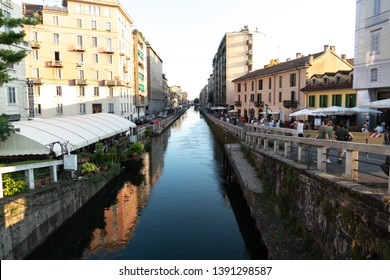 Milan, Italy - July 29, 2018: Naviglio grand canal. Navigli were a system of navigable and interconnected canals around Milan. Today, the Naviglio Grande and the Naviglio Pavese are a nightlife pole