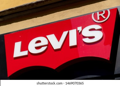 Milan, Italy - July 29, 2018: Levi's shop sign. Levi Strauss & Co. is a privately owned American clothing company known worldwide for its Levi's brand of denim jeans
