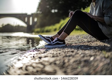 Milan, Italy - July 29, 2019: Young man wearing Vans Old Skool shoes and Adidas socks in the street - illustrative editorial