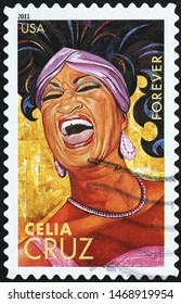 Milan, Italy – July 29, 2019: Portrait of Celia Cruz on american postage stamp