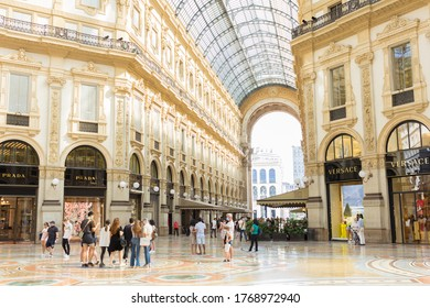 MILAN, ITALY - JULY 3, 2020: Pedestrians wearing protective face masks in Galleria Vittorio Emanuele II, Milan. Italy reopens everything after more than two months of nationwide lockdown.
