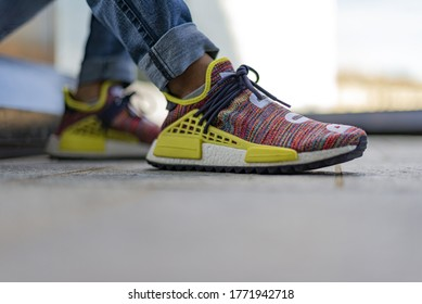 Milan, Italy - July 4, 2020: boy wearing Pharrell Williams Human Race Body and Earth NMD by Adidas on the street - illustrative editorial