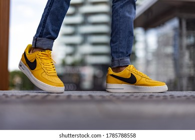 Milan, Italy - July 4, 2020: boy wearing Nike Air Force One LV '07 Yellow on the street - illustrative editorial