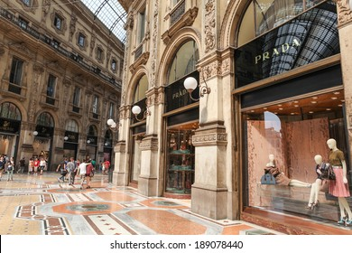 MILAN, ITALY - JULY 9, 2013: Prada Store in Galleria Vittorio Emanuele II shopping mall in Milan, with shoppers and tourists strolling around. Prada is an Italian luxury fashion house founded in 1913