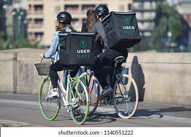 Milan - Italy , july22,2018 Uber Eats is an International food delivery company from U.S, Cyclist caring backpacks - home deluvery of food with bike