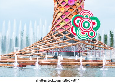 MILAN, ITALY - JUNE 01, 2015: The tree of life (Albero della vita in Italian) and close up detail of Expo 2015 logo, with Italian flag colors.