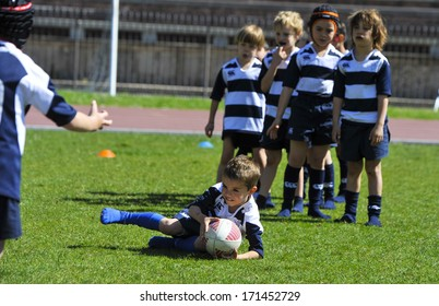 MILAN, ITALY - JUNE 02: children practicing during the Rugby camp at the Arena in Milan June 02, 2013.