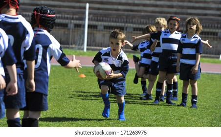 MILAN, ITALY - JUNE 02: Rugby school camp for children at the Arena in Milan June 02, 2013.