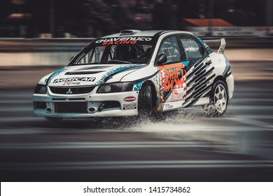 Milan, Italy, June 03, 2018: a white Mitsubishi Lancer Evolution in action during the 1st Drift Show Il Destriero at the Iper Drive in Milan.
