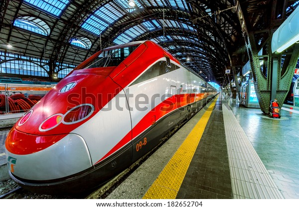 MILAN, ITALY - JUNE 07, 2012: Trenitalia Frecciarossa (red arrow) on Milan Central Station. This high speed train can reach 300 km/h and operate Turin-Milan-Bologna-Florence-Rome-Naples route.