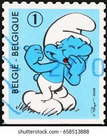 Milan, Italy - June 10, 2017: Cartoon smurf laughing on belgian postage stamp