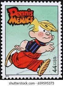 Milan, Italy - June 10, 2017: Dennis Menace on american postage stamp