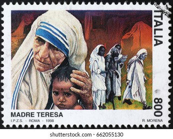 Milan, Italy - June 10, 2017: Mother Teresa and child on italian postage stamp