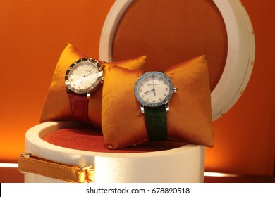 MILAN, ITALY, June 10, 2017: Bulgari Luxury Watches For Sale In Shop Window Display. Selective focus on the watch in the foreground