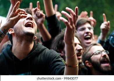 MILAN, ITALY - JUNE 10: unidentified group of people cheer during the Mi Ami music festival in Milan on June 10, 2011. The Mi Ami festival is held annually each June in Milan.