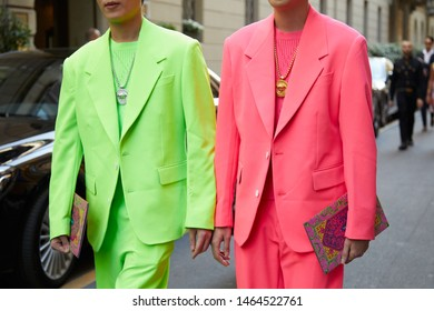 MILAN, ITALY - JUNE 15, 2019: Men with green and pink suit and silver and gold necklace before Versace fashion show, Milan Fashion Week street style
