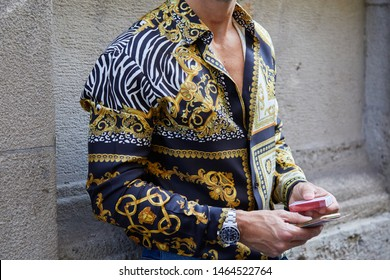 MILAN, ITALY - JUNE 15, 2019: Man with Versace shirt and Rolex Submariner watch before Versace fashion show, Milan Fashion Week street style