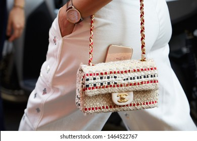 MILAN, ITALY - JUNE 15, 2019: Woman with Chanel bag and Breitling watch before Versace fashion show, Milan Fashion Week street style