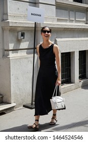 MILAN, ITALY - JUNE 15, 2019: Woman with black dress and sunglasses before Marni fashion show, Milan Fashion Week street style