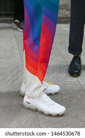 MILAN, ITALY - JUNE 15, 2019: Man with white Nike Vapormax Off White before Emporio Armani fashion show, Milan Fashion Week street style