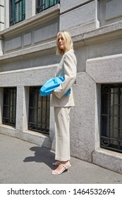 MILAN, ITALY - JUNE 15, 2019: Linda Tol with blue leather bag before Marni fashion show, Milan Fashion Week street style