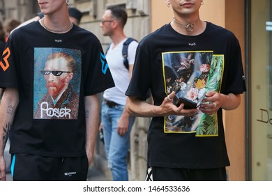 MILAN, ITALY - JUNE 15, 2019: Men with black shirt with colorful designs before Versace fashion show, Milan Fashion Week street style