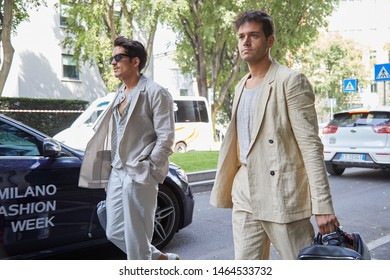 MILAN, ITALY - JUNE 15, 2019: Men with linen jacket and trousers before Emporio Armani fashion show, Milan Fashion Week street style