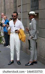MILAN, ITALY - JUNE 15, 2019: Elegant men with before Versace fashion show, Milan Fashion Week street style
