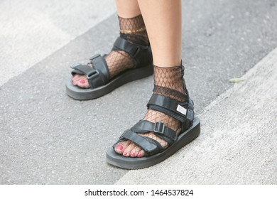 MILAN, ITALY - JUNE 15, 2019: Woman with black sandals and pink nail polish before Emporio Armani fashion show, Milan Fashion Week street style