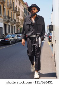 MILAN, ITALY -JUNE 16, 2018: Eccentric man posing for photographers in the street before REPRESENT fashion show, during Milan Fashion Week Men and women spring collections.