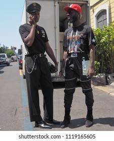 MILAN, ITALY -JUNE 16, 2018: Fashionable men posing for photographers in the street before REPRESENT fashion show, during Milan Fashion Week Men and women spring collections.