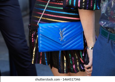 MILAN, ITALY - JUNE 16, 2019: Woman with blue leather Yves Saint Laurent bag before Etro fashion show, Milan Fashion Week street style