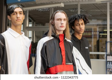 MILAN, ITALY - JUNE 16: Beautiful models pose in the backstage just before M1992 show during Milan Men's Fashion Week on JUNE 16, 2018 in Milan.