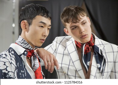 MILAN, ITALY - JUNE 16: Beautiful models pose in the backstage just before Miguel Vieira show during Milan Men's Fashion Week on JUNE 16, 2018 in Milan.