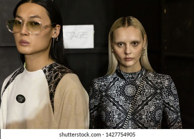 MILAN, ITALY - JUNE 16: Beautiful model poses in the backstage just before Youser show during Milan Men's Fashion Week on JUNE 16, 2019 in Milan.