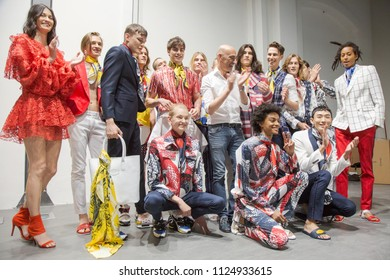 MILAN, ITALY - JUNE 16: Fashion designer Miguel Vieira poses with the models after his show during Milan Men's Fashion Week on JUNE 16, 2018 in Milan.
