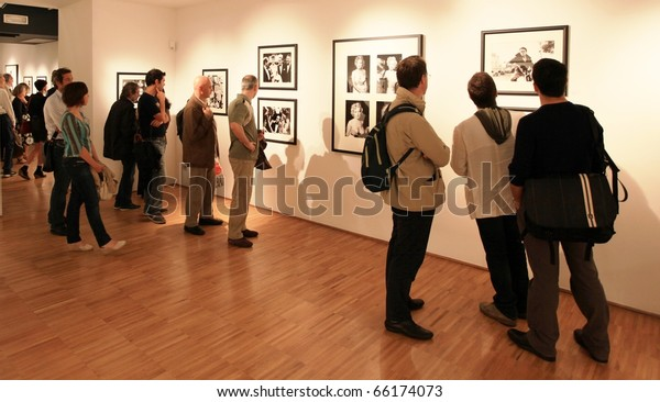 MILAN, ITALY - JUNE 16: Looking at Phil Stern photograhy exhibition at Forma Photography Foundation June 16, 2010 in Milan, Italy.