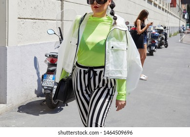 MILAN, ITALY - JUNE 17, 2019: Woman with yellow shirt and black and white striped trousers before Edithmarcel fashion show, Milan Fashion Week street style
