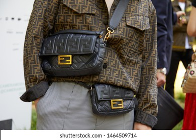 MILAN, ITALY - JUNE 17, 2019: Man with brown Fendi shirt and black leather bag before Fendi fashion show, Milan Fashion Week street style