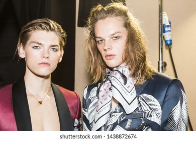 MILAN, ITALY - JUNE 17: Beautiful models pose in the backstage just before Miguel Vieira show during Milan Men's Fashion Week on JUNE 17, 2019 in Milan.