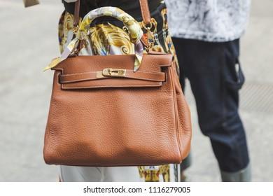 MILAN, ITALY - JUNE 17: Detail of bag outside Vien fashion show during Milan Men's Fashion Week on JUNE 17, 2018 in Milan.