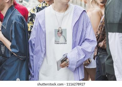 MILAN, ITALY - JUNE 17: Fashionable man poses outside Vien fashion show during Milan Men's Fashion Week on JUNE 17, 2018 in Milan.
