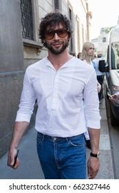 MILAN, ITALY - JUNE 17: Fashionable man poses outside Les Hommes fashion show during Milan Men's Fashion Week on JUNE 17, 2017 in Milan.