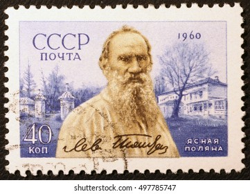 Milan, Italy - June 18, 2016: Leo Tolstoy on vintage russian postage stamp