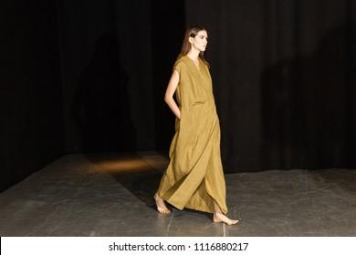 MILAN, ITALY - JUNE 18: Beautiful model poses in the backstage just before Sartorial Monk show during Milan Men's Fashion Week on JUNE 18, 2018 in Milan.